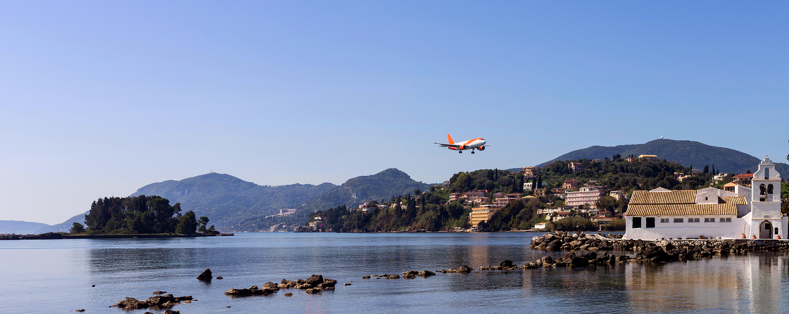 Plane landing over Vlacherna Monastery in Corfu